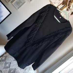 Black sweater dress with fringe